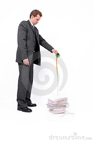 Businessman destroying documents