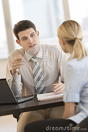 Businessman Discussing Plan With Colleague In Office