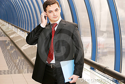 Businessman with documents on phone