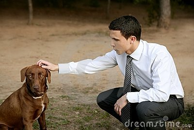 Businessman with dog outdoor in park
