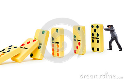 Businessman and dominoes