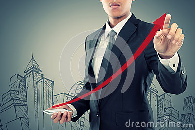 Businessman drag a rising arrow at smartphone