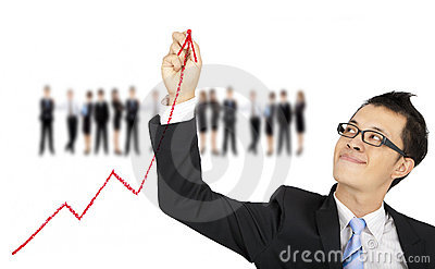 Businessman drawing business graph