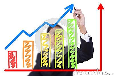 Businessman drawing graph grow