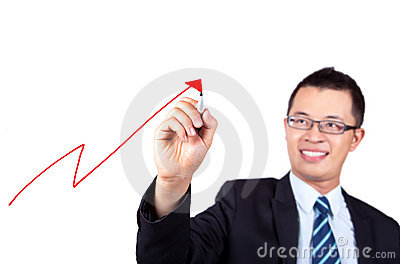 Businessman drawing profit graph