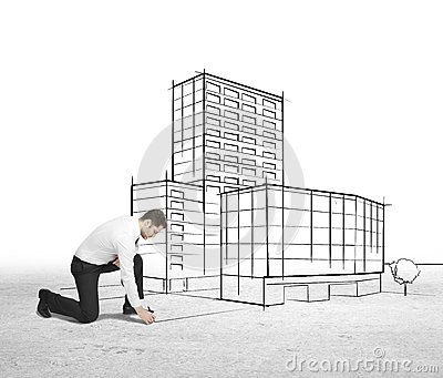 Businessman drawing skyscraper