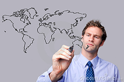 Businessman drawing the world map on a glass scree