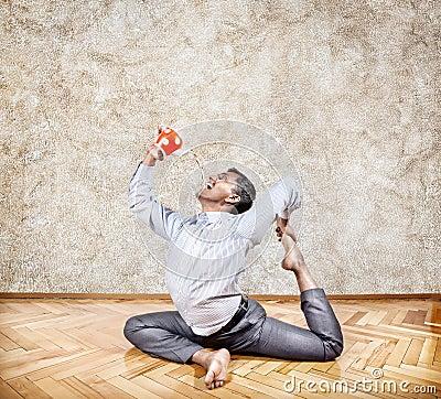 Businessman drinking tea in yoga pose