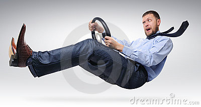 Businessman driver with  a wheel