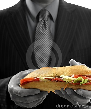 Businessman eating junk fast food