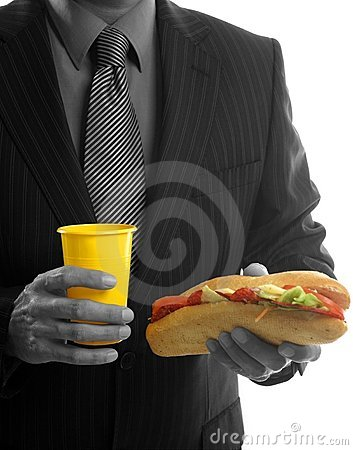 Businessman eating junk fast food