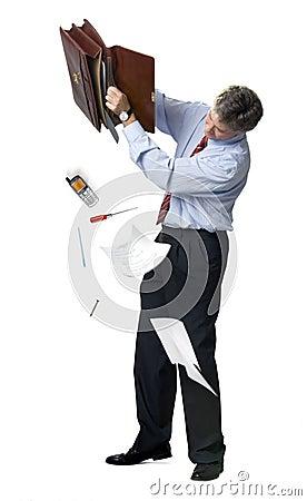 Businessman emptying a briefcase