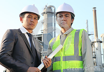 Businessman and engineer oil refinery
