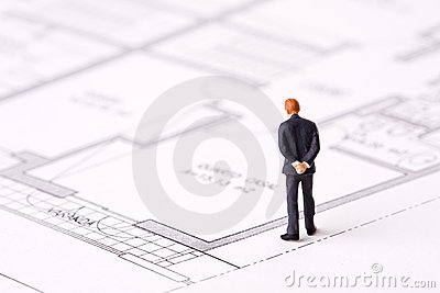 Businessman examining a blueprint