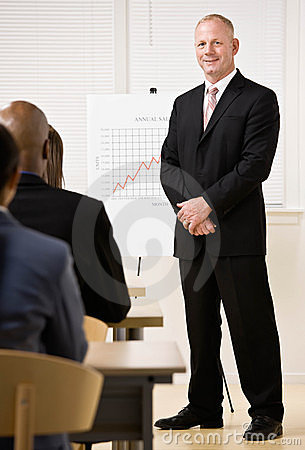 Businessman explaining analysis chart