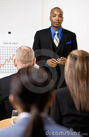 Businessman explaining financial analysis chart
