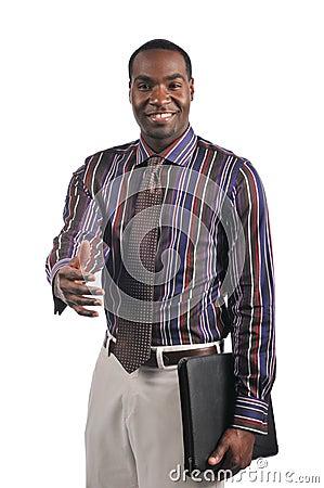 Businessman extending a hand shake