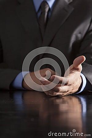 Businessman Extends Hand