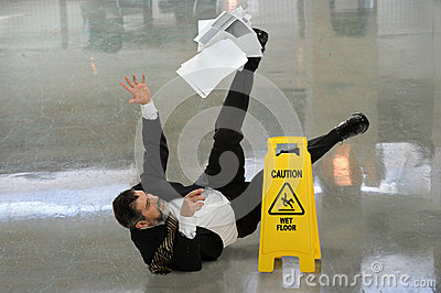 Businessman Falling on Wet Floor