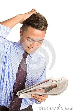 Businessman feeling despair with news