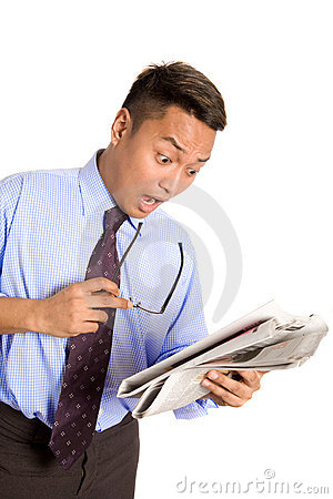 Businessman feeling shock with news