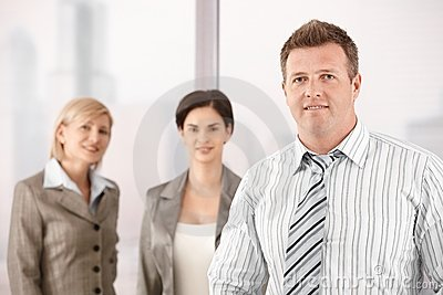 Businessman with female coworkers