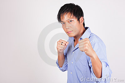 Businessman in a fighting pose