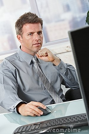 Businessman Focusing On Task Royalty Free Stock Photography - Image: 22664877