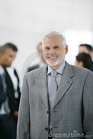 Businessman in front of sales team