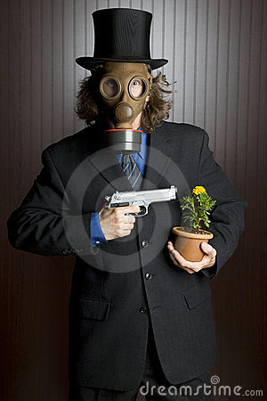 Businessman, gas mask, gun and flower