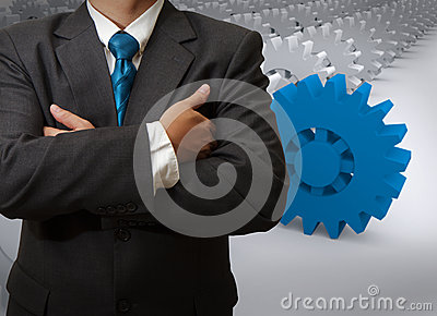Businessman and gear to success