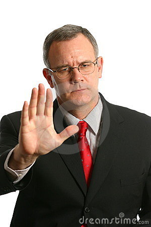 Businessman in gesturing for someone to stop