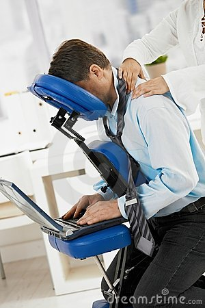 Businessman getting neck massage