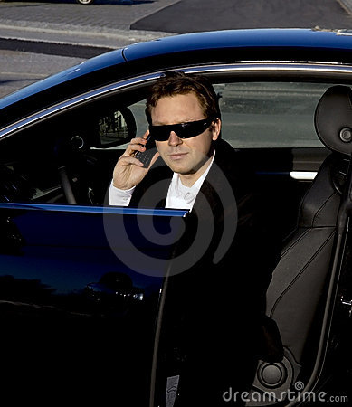 Businessman getting out of a car