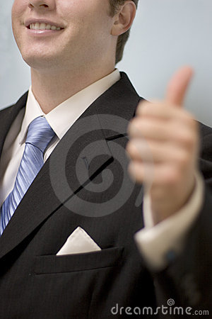 Businessman gives thumbs-up