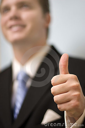 Businessman gives thumbs up