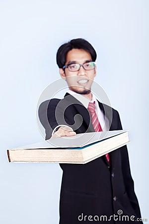 Businessman giving book