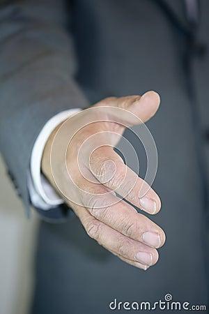 Businessman giving hand