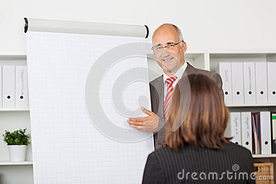 Businessman Giving Presentation To Female Coworker