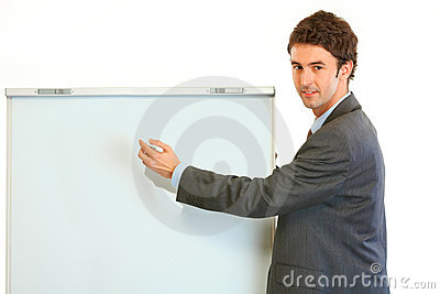Businessman giving presentation using flipchart