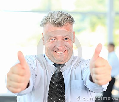 Businessman giving you thumbs up