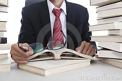 Businessman with glasses and books
