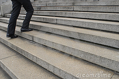 Businessman going up stairs