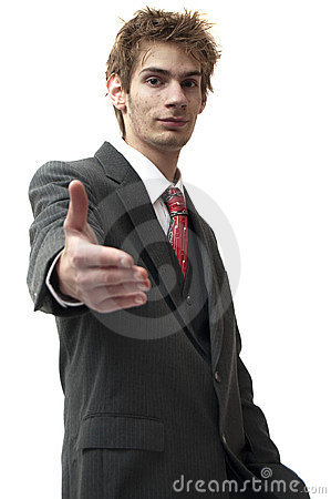 Businessman Greets A Smile And Handshake