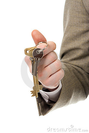 Businessman hand holding key to success