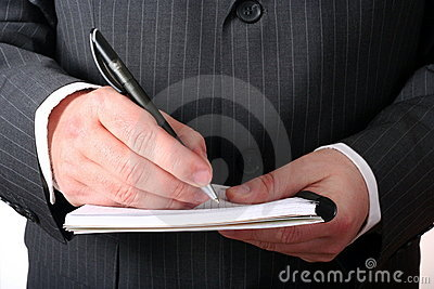 Businessman hand making notes