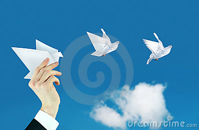 Businessman hand and paper dove collage