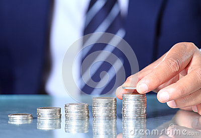 Businessman hand put coins