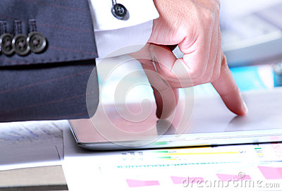 Businessman hand touch tablet