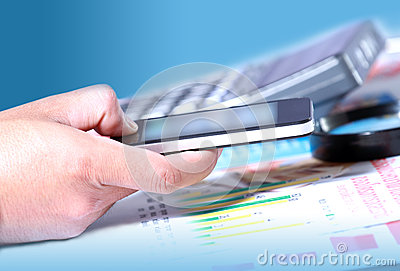Businessman hand using smart phone